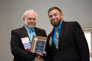Sean Brooks (right) accepts award for Valencia's chapter of the Florida Engineering Society.