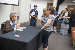 Temple Grandin (left) signs copies of her books.