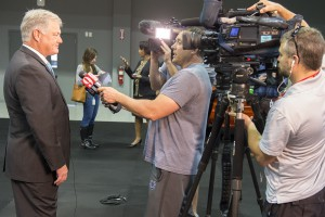 News crews interview Valencia president Dr. Sandy Shugart after the announcement.