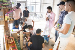 The students used a wide variety of materials -- including dominoes, playing cards and lots of duct tape -- to build their Rube Goldberg machines.