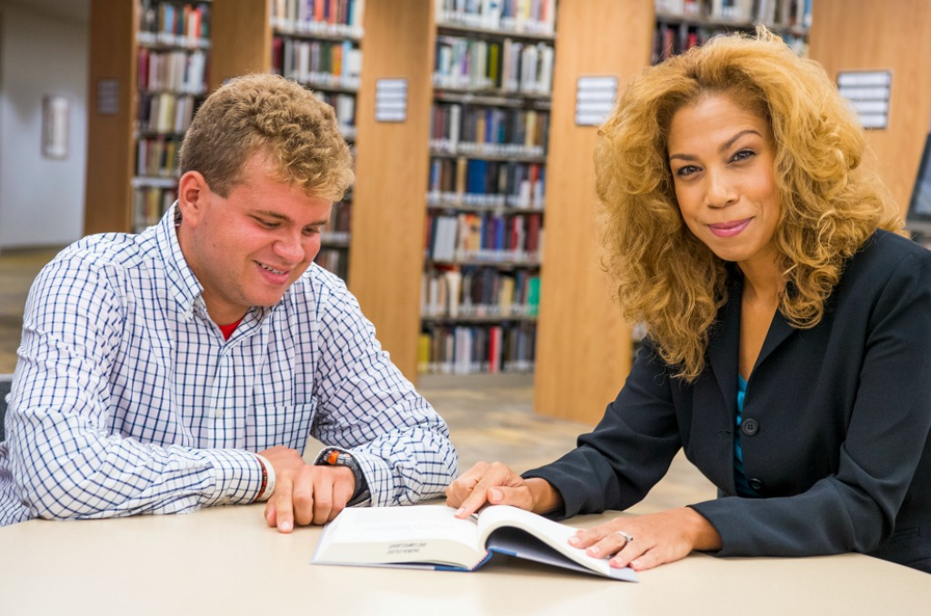 Valencia grad Archie Brechin (left) and his professor and mentor, Dr. Bahiyyah Maroon, work together in the East Campus library.