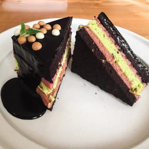 From the 1921 dessert menu: Chocolate cake with strawberry custard, pistachio cake, chocolate mousse & chocolate ganache.