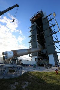 NASA and United Space Alliance workers move an Atlas V rocket into vertical position at Cape Canaveral Air Force Station. (NASA photo.)