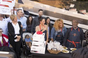 Al Roker and Sunny Anderson give culinary student Sasha Sincic a set of All-Clad pans.